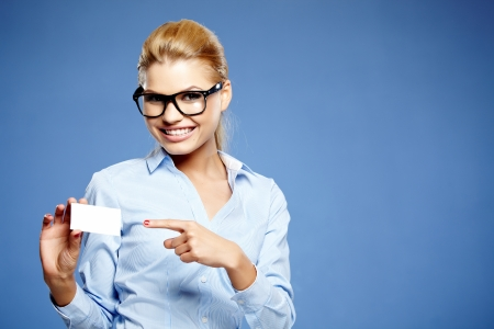Businesswoman holding credit card  Isolated on blue photo