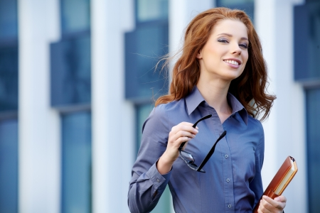 Young happy women or student on the property business background Stock Photo - 20104687