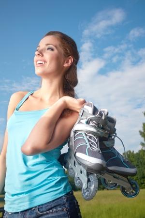 roller blade: roller skating woman in park