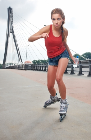 Young woman on roller skates photo
