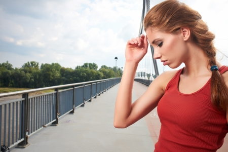 Beautiful woman pose after fitness training on bridge photo