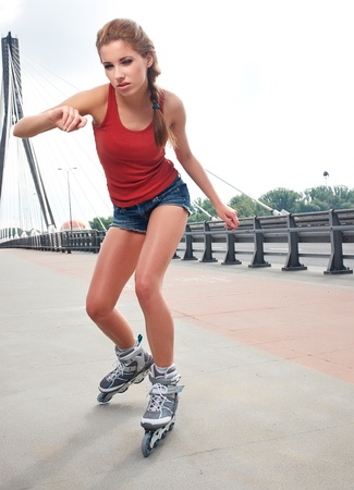 rollerskating: Young woman on roller skates