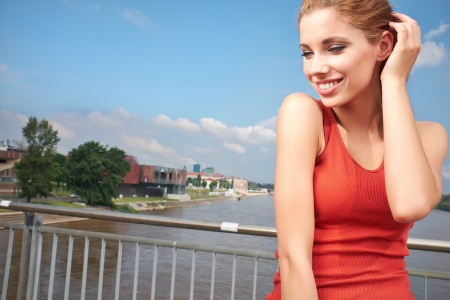Smiling fitness woman City river  background photo