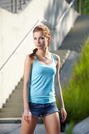 rollerskating: Beautiful young woman on sunny summer day
