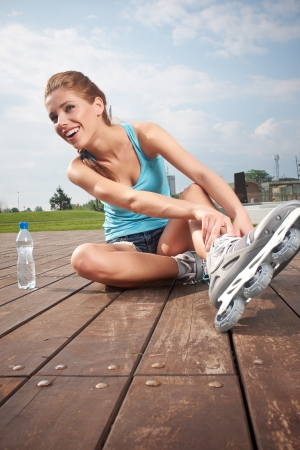 rollerskating: Roller girl resting on the steps
