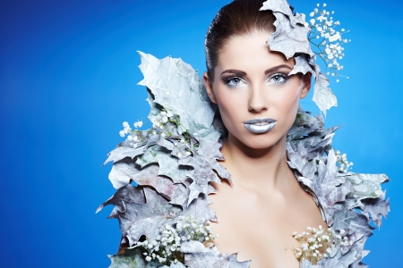 Young woman in creative image with silver artistic make-up. Stock Photo - 20663926
