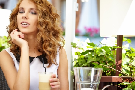 A pretty young woman in a cafe  Outdoors  photo