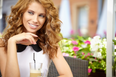 Fashion woman sitting on the bench in the cafe  photo