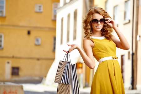Shopping woman in city photo