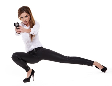 young beauty woman holding handgun photo