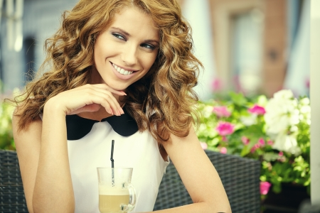 Charming woman in a restaurant  photo