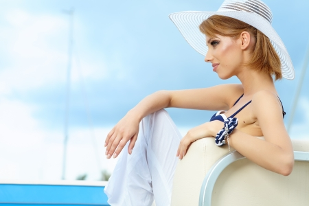 yacht people: Outdoor portrait of a beautiful summer woman in hat