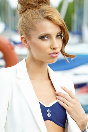 sexy fashionable woman standing in a port fashion style, yachts  photo