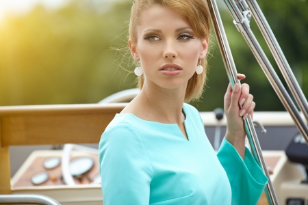 Elegant retro woman wear  dress , sitting near the wooden yacht  60 photo