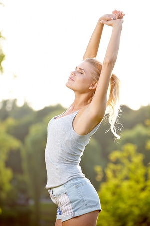 gasp: Relax in grass - tired woman after sport