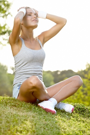 Relax in grass - tired woman after sport  photo