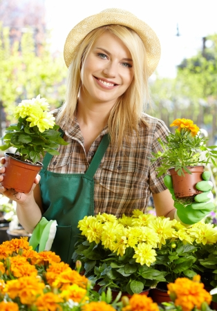 Florists woman working with flowers at a greenhouse. photo