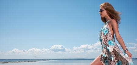 Elegant  woman wear dress in motorboat photo