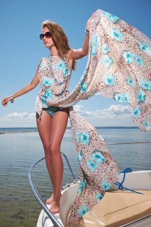 Elegant  woman wear dress in motorboat Stock Photo - 21064210