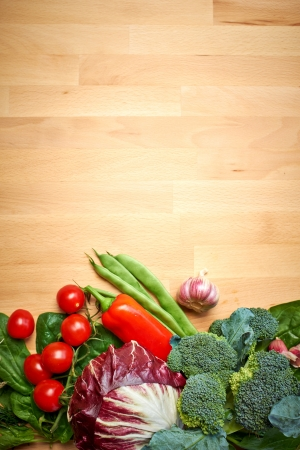 abstract design background vegetables on a wooden background  photo