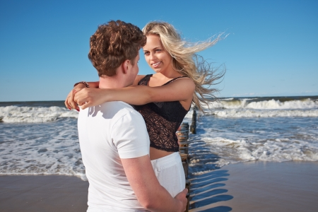 Smiling young couple  at beautiful summer beach  photo