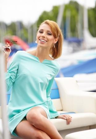 women s fashion: Elegant retro woman wear dress ,  near the yacht marine    Stock Photo