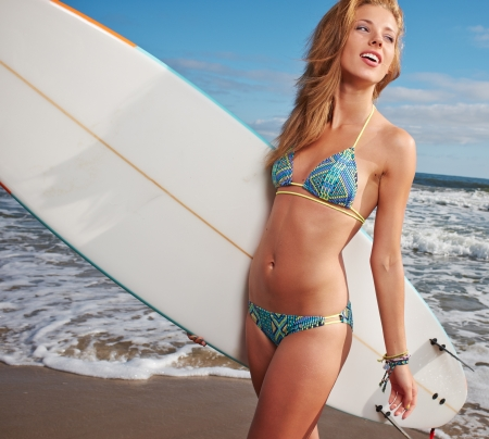 Surfer girl on the beach photo