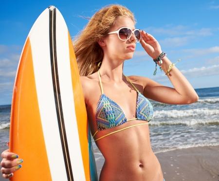 surf girl: Surfer girl on the beach