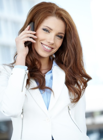 Businesswoman with mobile phone  Stock Photo - 21439489