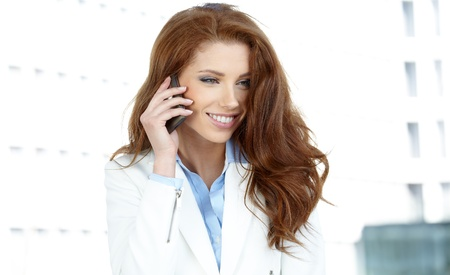Businesswoman with mobile phone Stock Photo - 21439490