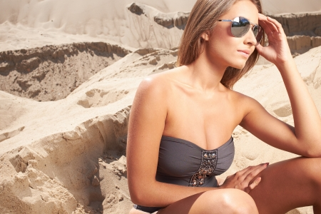 woman sleep: Romantic relaxed woman in bikini on sand sunbathing and resting  Stock Photo