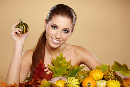 Woman with  autumn pumpkin and leaves   photo