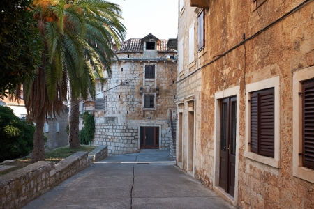 Narrow Alley With Old Buildings In Typical Croatia Medieval Town  photo