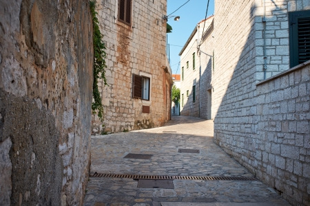 siena: Narrow Alley With Old Buildings In Typical Croatia Medieval Town  Stock Photo