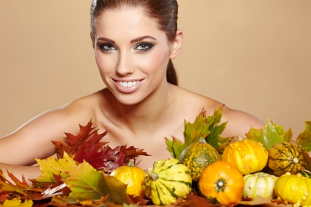 Woman with  autumn pumpkin and leaves.  photo