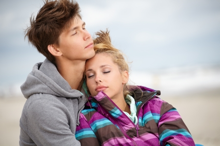 Romantic Young Couple On Winter Beach  photo