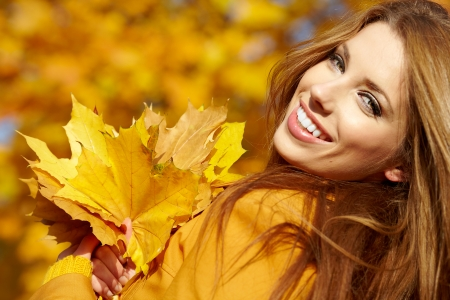 Autumn woman on leafs background  photo