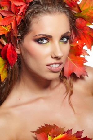 Autumn Woman portrait with creative  makeup  photo