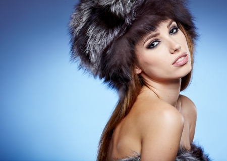 Fur Fashion  Beautiful Girl in Fur Hat  Winter Woman Portrait Stock Photo - 22334432