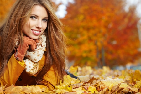 autumn woman on leafs  photo