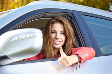 Smiling young pretty woman in the car  Stock Photo