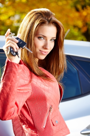 Car driver woman smiling showing new car keys and car Stock Photo - 22677736