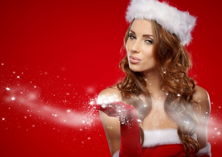sexy christmas: christmas woman on red background Stock Photo