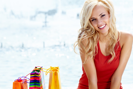 Happy young woman shopping  photo