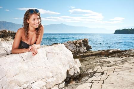 woman portrait on the sea stone  photo