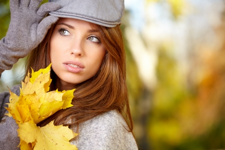 happy fall woman smiling joyful and blissful holding autumn leaves outside in colorful fall forest   Stock Photo - 23182971