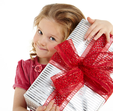 Little girl with christmas gift photo
