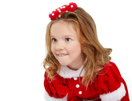 Cute little girl in the santa claus costume photo