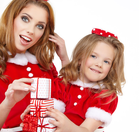 Woman and little girl wearing santa claus costume photo