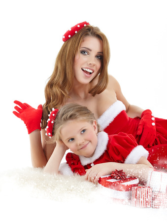 Beautiful woman and little girl dressed in costume santa claus photo